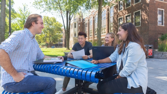 Students on campus working together outside