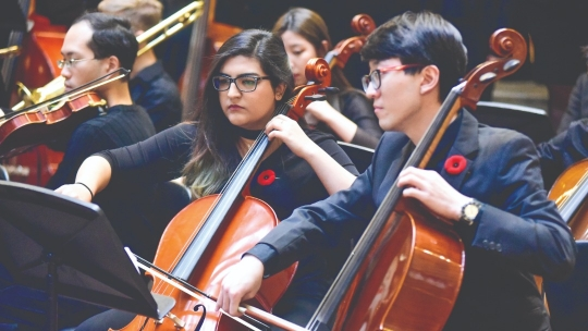 University of Toronto students playing instruments on Remembrance Day